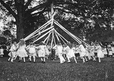 Children enjoying a Maypole dance, 1915