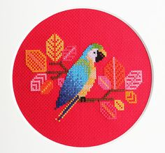 I was so in love with the first parrot design I made.... I had to do another! Meet Blue Parrot, the latest addition to my aviary collection. The cheerful and vibrant colour palette makes me think of tropical forests, and exotic creatures! This little guy will be a colourful and textural focal point in any room it ends up in. Please note that this is a downloadable PDF pattern, and does not come with the supplies required to make this piece. You do however get all of this: - reference cover…