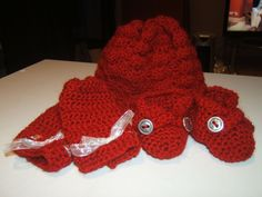 Baby Hat, mittens, and booties I made for a friend.  Scarlet red
