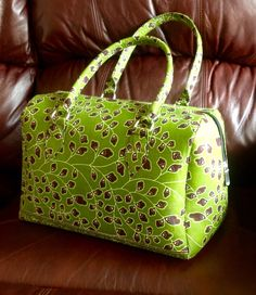 Love it! Ankara handbag, African print - green/brown. Makes for a unique gift or keep for yourself. Great price @ $60. Will ship. Janeth_Okoronkwo@yahoo.com