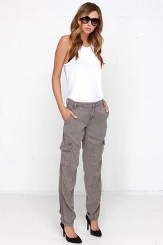 It's no coincidence that a synonym for cargo is goods! The Blank NYC For Sure Washed Grey Cargo Pants go beyond great, making this classic design better than ever! Soft, woven Tencel composes a relaxed-fit with cargo pockets at the sides, a cool washed finish, and plenty of seamed details. Diagonal front pockets and back snap pockets add both a practical and cute element. Hidden zip fly with top button closure. Unlined. 100% Tencel. Machine Wash Cold.
