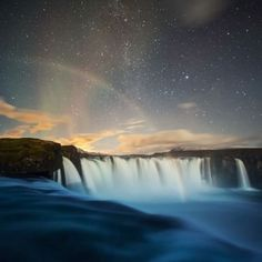 Two rare atmospheric phenomena (The Northern Lights and a Moonbow) collide over Goðafoss in Northen Iceland.
