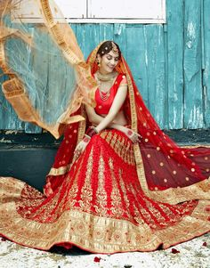 Red designer wear Indian Punjabi lehengha choli for bride