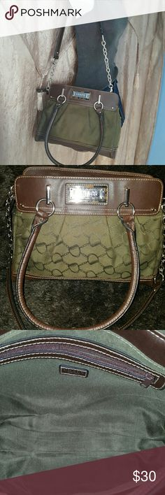BNWT CHAPS POCKETBOOK It has one zippered pocket and 1 compartment inside. it has two outer pockets with snaps. Can be worn over the shoulder with the strap or you can use it as a hand-held purse with the two smaller handles Chaps Bags Satchels