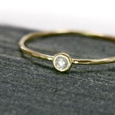 White Diamond 14k Gold Stack Ring - Genuine Diamond in solid 14k Yellow Gold bezel setting on a thin hammer textured band - Made to order. $169.00, via Etsy.
