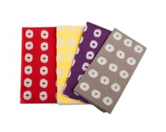 Set of 8 napkins is a stylish way to bring summer to the table. Made from 100% cotton, each napkin features fashionable ikat-inspired designs. Set of 8 includes 2 each of red, yellow, natural, and purple napkins.