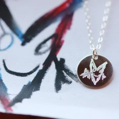 Wear your childs masterpiece close to your heart with the ESD Work of Art Necklace. This charm is engraved with your childs artwork on the front, and their name on the back.