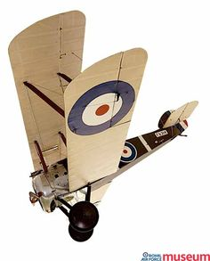 """Sopwith F.1 Camel.    The Camel shot down more enemy aircraft than any other Allied fighter. Its twin Vickers guns were placed in front of the cockpit, and had a metal fairing over the breeches which created a """"hump"""" shape, giving it its name."""