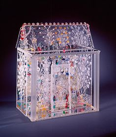 Howard Finster | American, 1916–2001 | In My Father's House Are Many Mansions, #4,392 | 1985 | Plexiglass, plastic, beads, plastic toys, and sequins | 18 x 14 5/8 x 9 inches | T. Marshall Hahn Collection | Number: 1997.72