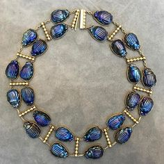 Favrile glass and gold scarab necklace by Louis Comfort Tiffany for circa on offer auction of on April 25 in Glass Jewelry, Charm Jewelry, Gold Jewelry, Beaded Jewelry, Jewelery, Fine Jewelry, Jewelry Box, Bijoux Art Nouveau, Louis Comfort Tiffany