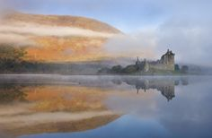 A misty morning beside Loch Awe with views to Kilchurn Castle, Argyll & Bute in Scotland