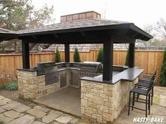 Pergola over an outdoor kitchen made with natural stone. What could be better for your outdoor entertaining? | Landscape St. Louis | www.landscapestlouis.com/services