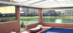 Terraza acristalada con cortinas de cristal sin perfiles en Madrid realizada por Cerramientos Abatibles http://www.jardindeplantas.com/portada/2015-09-28