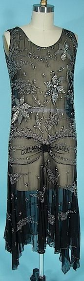 ... somehow the crotch-level focal point MAKES this dress for me... perhaps the era of the prominent crotch has come?  c. 1928 Black Chiffon Beaded Flapper Dress