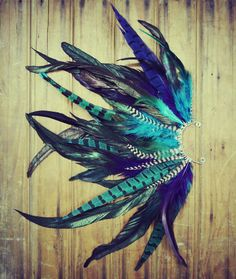 Handmade Large Feather Ear Cuff, Peacock Feathers, Grizzly Feathers, Blue, Hippie, Bohemian, Tribal, Aztec, Hair Feathers. $45.00, via Etsy.