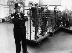 Police detain Parka wearing youths in parcel trucks before putting them on the train out of Brighton Framed Print Framed, Poster, Canvas Prints, Puzzles, Photo Gifts and Wall Art Multimedia, Framed Prints, Canvas Prints, National Photography, Made In America, Brighton, Poster Size Prints, Britain, Photo Mugs