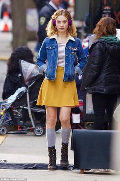 Fresh and funky: On Saturday actress Lily James proved she had moved on from the period fashion of Downton Abbey as she sported this bold look on the set of her upcoming film Baby Driver in Atlanta