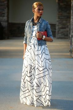 Jean jacket layered over a black and white geometric print maxi dress