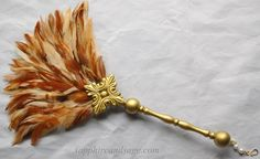 Maria Renaissance Feather Fan www.sapphireandsage.com  This two-sided hand-made Renaissance Feather Fan has been created with glossy hackle feathers and accented with hand-painted ornamental plaquettes finished with your choice of accent color.