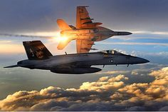 Super Hornets Two U. Navy Super Hornets of Strike Fighter Squadron 31 fly a combat patrol over Afghanistan. The ability and technology of these military planes are beyond words! Aaron Allmon, U. Military Jets, Military Aircraft, Military Weapons, Military Brat, Military Deployment, Military Women, Fighter Aircraft, Fighter Jets, Top Gun Movie