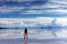 Salar De'Uyuni, Bolivia....The world's largest salt flat. During the rainy season, the water turns it into the world's largest mirror and the reflection of the sky creates a sense of infinity, as if you're walking through the clouds.  Yes, please.