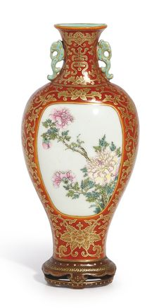 A coral-ground gilt-decorated famille-rose wall vase, seal mark and period of Qianlong