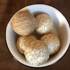 styrofoam ball covered with jute and styrofoam balls covered with strips of cut pages from an old book! Jani'sjunque