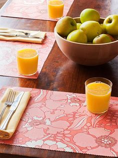 """Easy care place mats: To start, gather fabric (heavier, """"home decorating"""" weight works best), pinking shears, and iron-on vinyl topping, which is available at most fabric stores. Cut fabric into 12""""-by-17"""" rectangles; iron. For each mat, cut two rectangles of the same size from the vinyl. Following package directions, iron a piece of vinyl onto each side of the place mat; use pinking shears to trim the edges of your mats. You'll be able to sponge away any spills."""