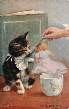 KItten, tea cup and doll.