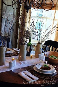 tablescape - love the vases and sticks for a good winter themed table for January