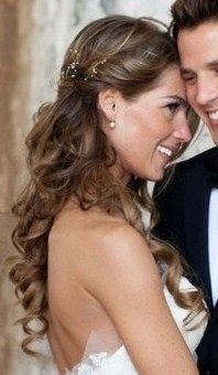 Bridal hairstyle is so beautiful with those flowing curls, sure to captivate any groom!