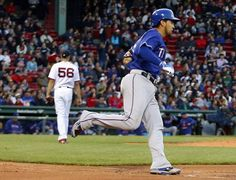 May 20, 2015; Boston, MA, USA; Texas Rangers catcher Robinson Chirinos (61) rounds first base as Boston Red Sox starting pitcher Joe Kelly (56) walks away after his solo home run during the third inning at Fenway Park. Mandatory Credit: Winslow Townson-USA TODAY Sports