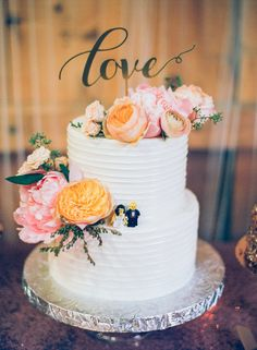 """Modern wedding cake idea - two-tier wedding cake with textured frosting + pink peonies and peach garden roses with """"love"""" cake topper {Analog Wedding}"""