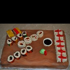 Sushi themed cake with Rice Krispie treat sushi.