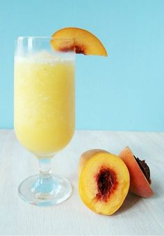 Peach Bellini -  1/2 cup peach puree – chilled 1 teaspoon sugar 1 teaspoon fresh squeezed lemon juice 1/4 cup peach schnapps 1 cup crushed ice – more if necessary 1 cup Prosecco – chilled – more reserved for topping off glasses| thinly sliced peach wedges – to garnish {optional}