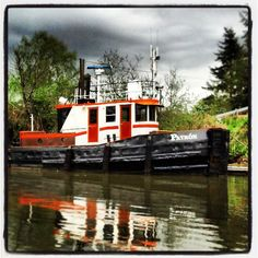 A tug boat in the Snohomish River with ominous clouds hovering above. Was taken on 4/20/13.