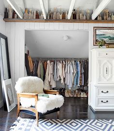 The 18 Most Beautiful Attics You'll Ever See via Brit + Co. - wardrobe in sloping ceilling