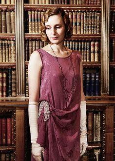 Lady Edith Crawley dressed in evening attire with long opera lenght crystal necklace
