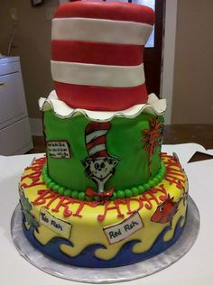 Dr. Seuss Cat in the Hat Cake. The hat is made of rice cripsy treats and covered in fondant. All the decorations are made of fondant and hand painted