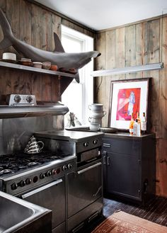 """SHARK! Panneled small kitchen with industrial stove. """"How to Support a Decorating Habit"""" - Slide Show - NYTimes.com"""