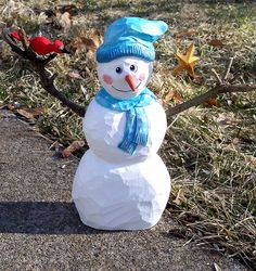 Snowman and friend by Geppetto22, via Flickr