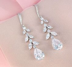 This elegant but dainty set of dangling long leaf crystal earrings are from CherryHillsBridal via etsy. #weddingearrings #crystal #danglingearrings