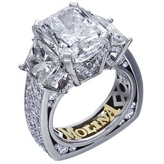 latinum three stone engagement ring containing one 6.22 carat radiant diamond, two trapezoidside stones weighing 2.68 carats, and 1.59 carats of round brilliant diamonds.