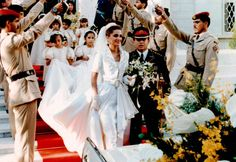 Royal Wedding -♔♛Queen Rania of Jordan♔♛...  Rania was just 22 years old when she married Prince Abdullah in 1993. The brunette beauty wore a white and gold gown designed by Bruce Oldfield and matching white and gold shoes.