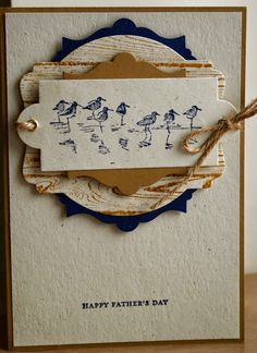 "By Gina Wiseman. Sandpipers from ""Wetlands"" (Stampin' Up) stamped in navy on white die-cut tag. Die cut other shapes from brown, white, & navy to layer under the image panel. Stamp the ""Hardwood"" stamp (Stampin' Up) in brown on the blank white die-cut. Attach white panel to kraft cardstock base. Layer die-cuts on the card front, popping up the brown & navy ones."