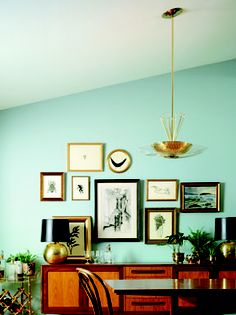 Aqua paint -- The Meteor, Mid-Century Modern light fixture, enlivens a dining room.