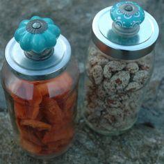 Cabinet knob on a pasta sauce jar.