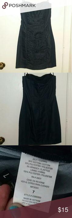 Dark Blue XOXO Sleeveless Dress Features figure flattering rouching. Zip up back with fastener. XOXO Dresses Strapless