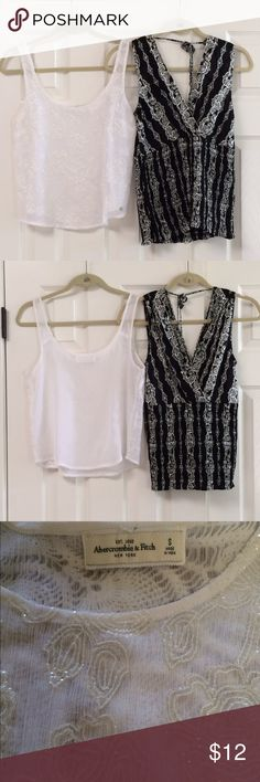 """Bundle of 2 summer tops The A&F what top as an intricate floral design on the front and fabric is very sheer size small.  The black and white top has tags missing but believe it is WHBM.   Blacktop has bra guides in the shoulders. Flat bust measurement on both tops is about 18"""".   *Gently washed and worn.  *Condition: Good, used, functional could be one/few minor flaws. No noticeable rips or stains. We try to note every flaw but sometimes we miss the smallest ones please be aware of this…"""