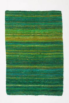 Grass Striped Rug from Anthropologie.  Amazing texture and beautiful, bright colors.